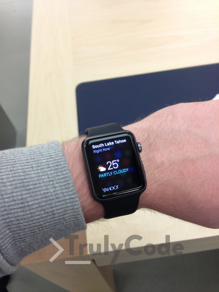 Black Apple watch on wrist